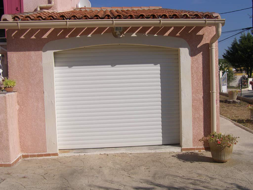 Porte de garage à volets roulants